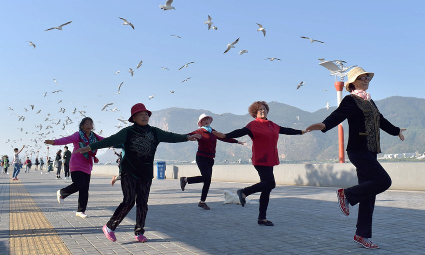 chinese pensioners exercise in open air