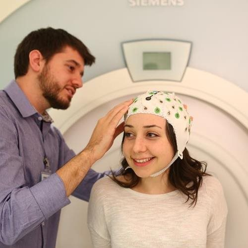researcher and study participant with MRI cap at Baycrest