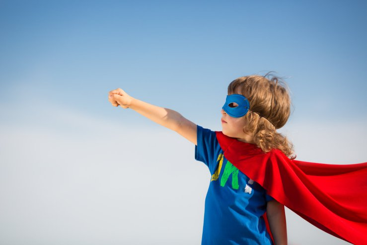 child aiming to be superman