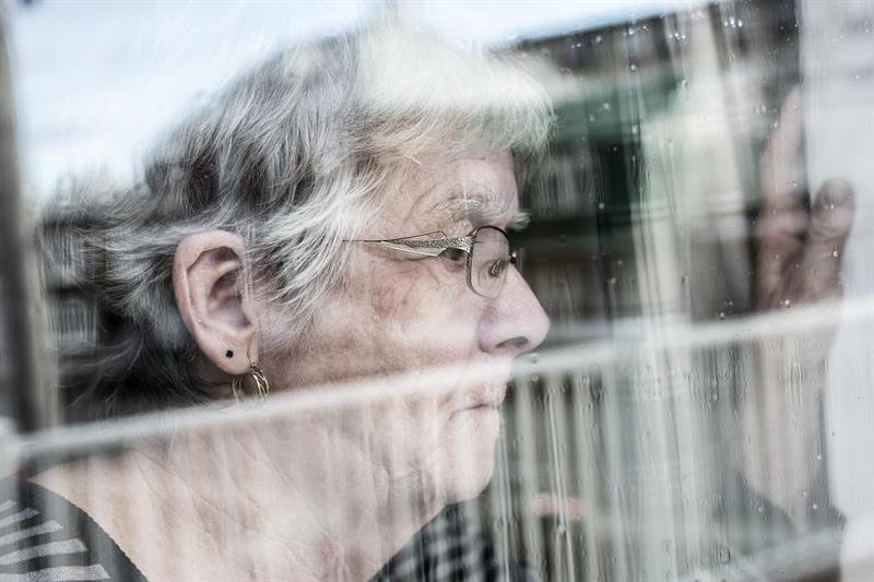 dementia patient looking through window