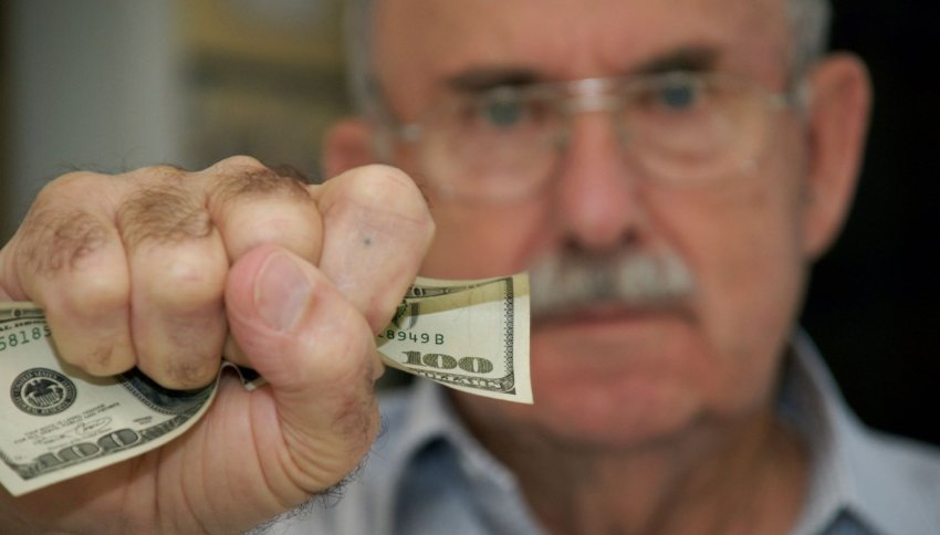 elderly handling money