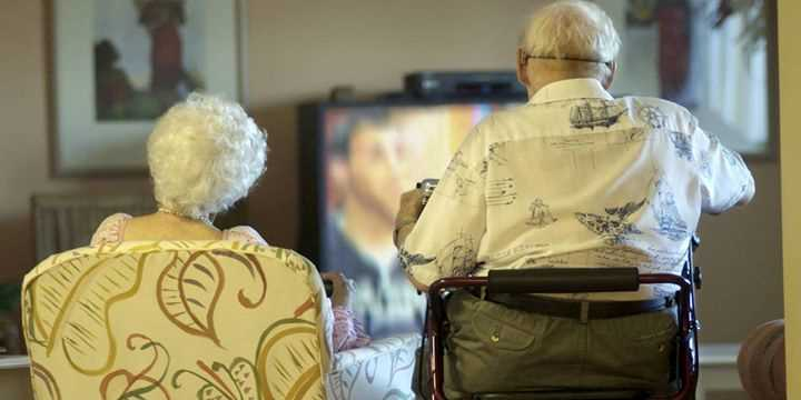 elderly people watching tv