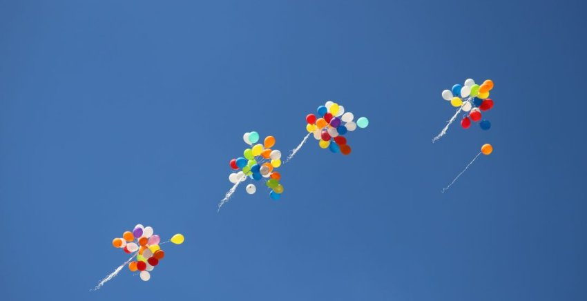 flying away balloons