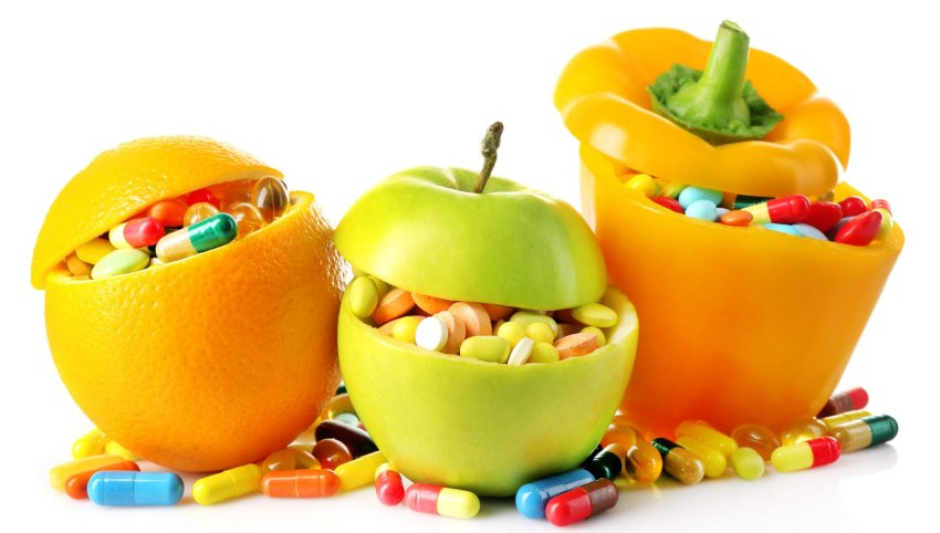 fruits filled with vitamin pills