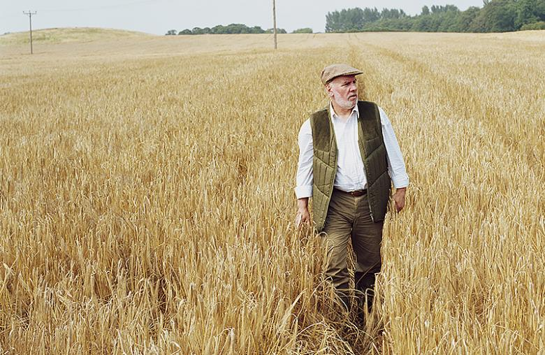 man wandering in field