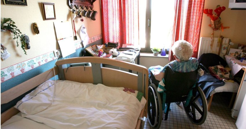 senior lady on wheelchair in care home