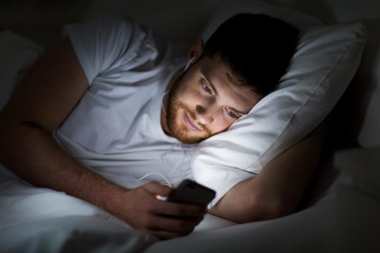 watching phone in bed