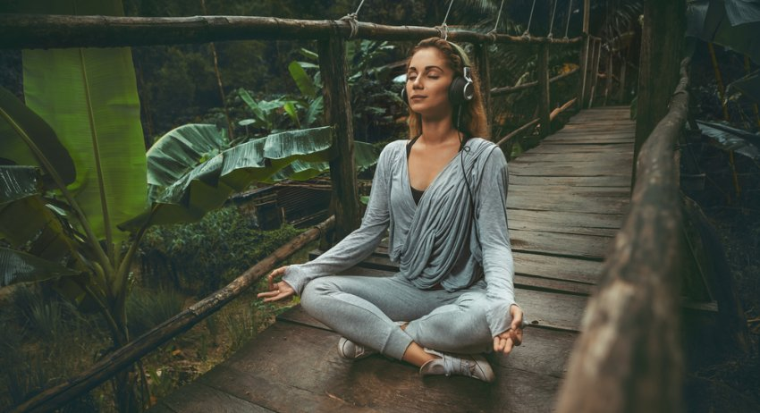 woman meditating and listening to music